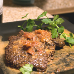 Delicious, tender cube steak in tomatoes, cream, and wine.