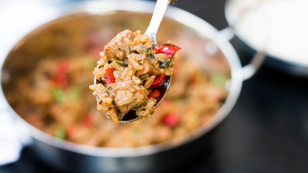 Pork jambalaya with burnt sugar - browned sugar, tender pork pieces cooked with rice and veggies. Cajun goodness!