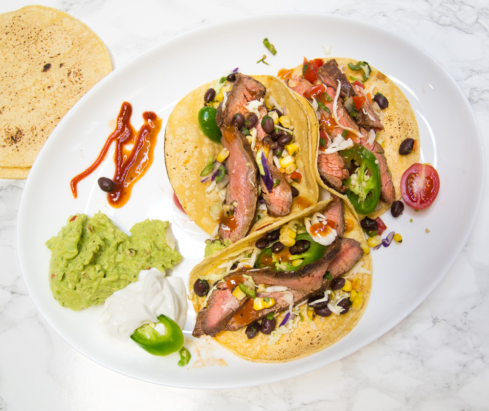 Smoky, tender grilled flank tacos! Let tacos rule!
