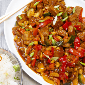 Kung pao tofu is chock full of veggies in a delicious, slightly spicy sauce! Did I mention easy? The sauce has only 3 ingredients and you can use whatever veg you have on hand - all done in about 30 minutes! Perfect for the tofu newbie too!
