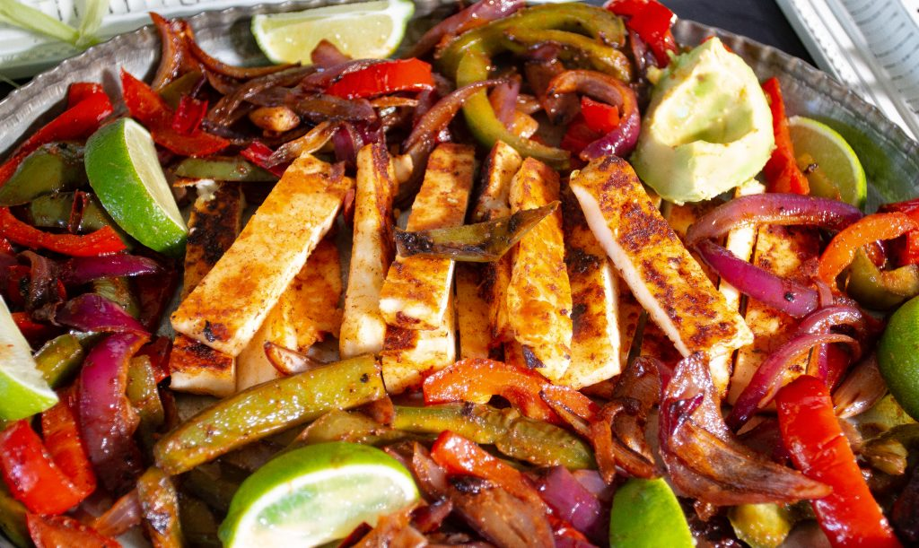 Squeaky, delicious halloumi cheese make the perfect filling for fajitas.  If you're looking for a quick, easy weeknight dinner or any night dinner, these halloumi fajitas are just what you're looking for!  High in protein with a delicious umami flavor, you won't miss the meat.  Promise!