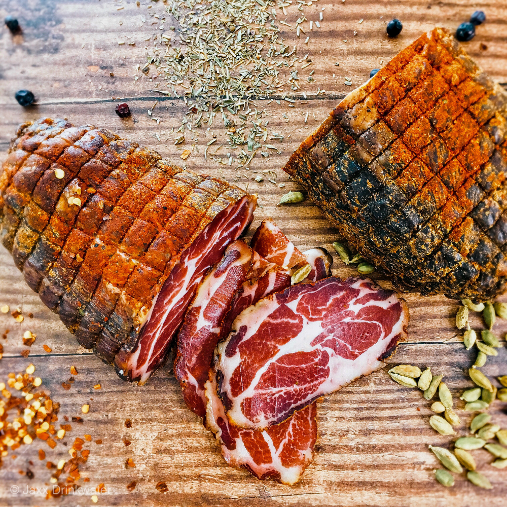 Love charcuterie? Homemade capicola is easy to make right in your fridge. It's made from the coppa muscle of a pig and once cured and dried the results are buttery and decadent! Don't be afraid - try it! #capicola #charcuterie #jaxxalicious