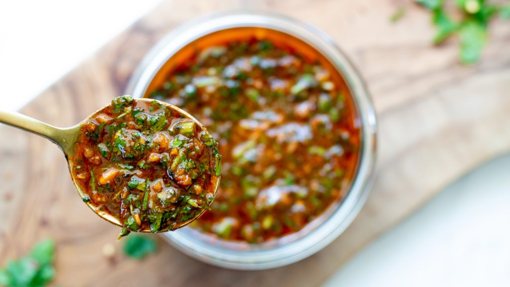 Smoky red chimichurri sauce will absolutely become your go-to, put it on everything sauce.