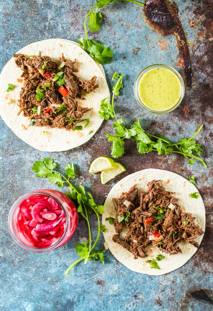 Flavor Bomb Barbacoa - Tender, shredded beef cooking in a flavor bomb sauce. In the Instant Pot, or any pressure cooker, you can have barbacoa any time you want!