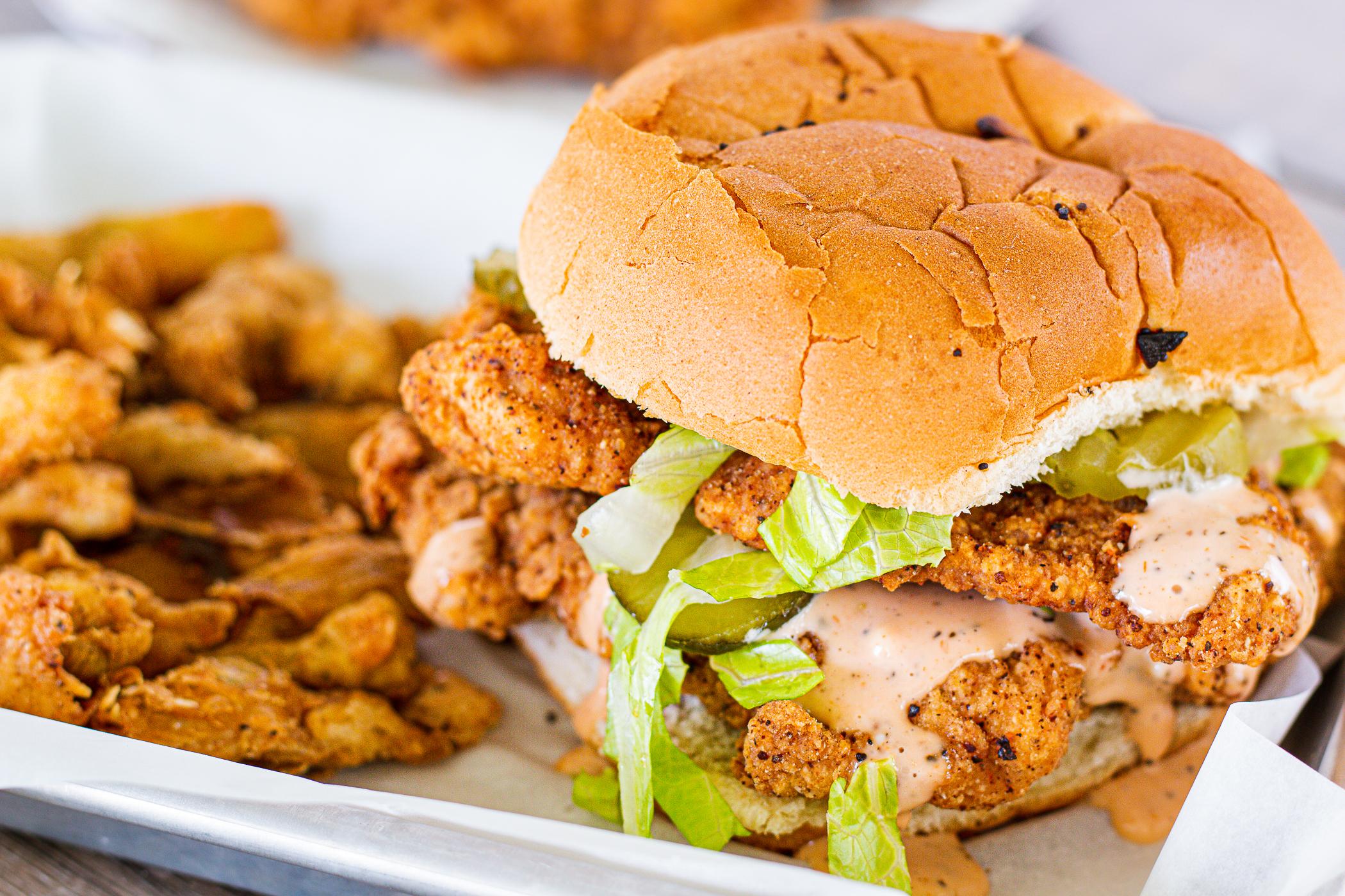 Fried pork tenderloin sandwich is not the healthiest, but it sure is delicious!
